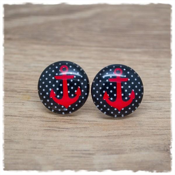 1 Paar Ohrstecker mit rotem Anker auf schwarz weißem Hintergrund