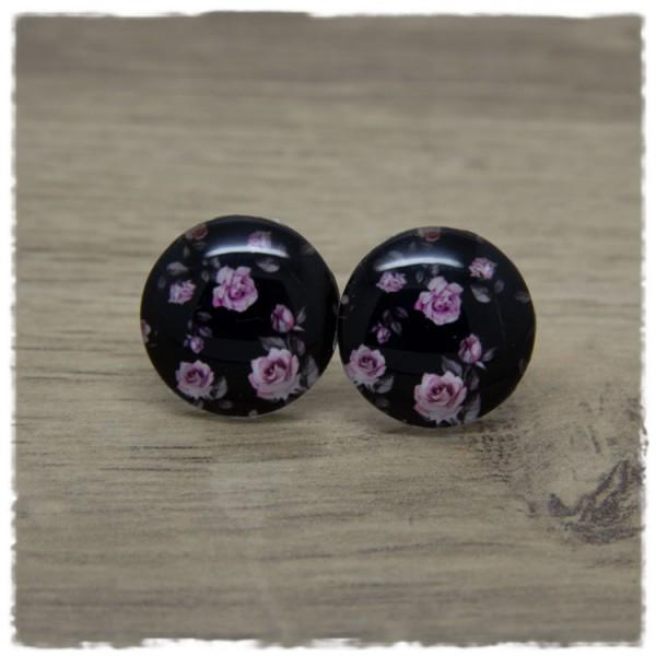 1 Paar Ohrstecker mit rosa Rosen auf schwarzem Hintergrund