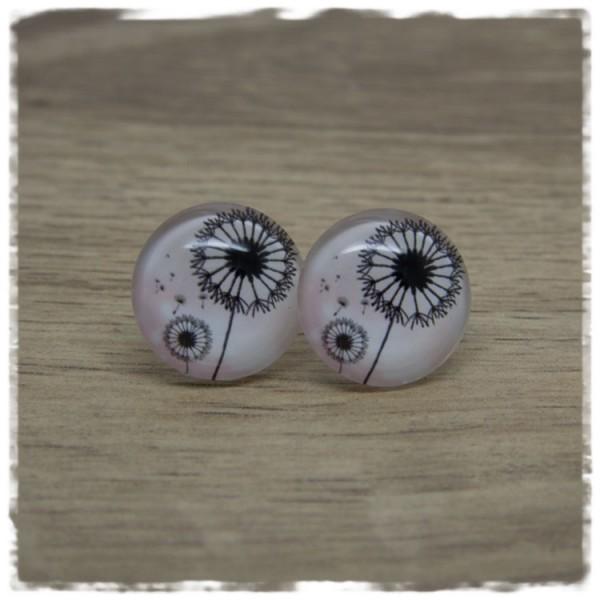 1 Paar Ohrstecker mit Pusteblumen auf rosa Hintergrund