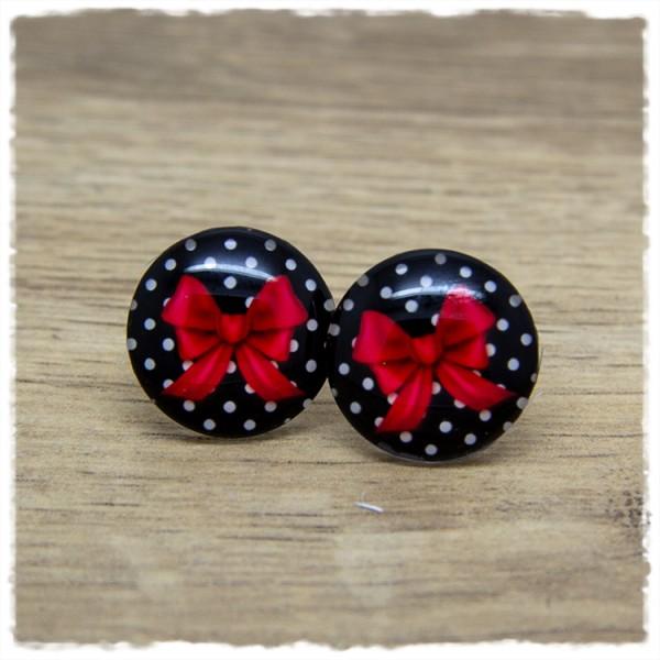 1 Paar Ohrstecker mit roter Schleife auf schwarz weißem Hintergrund