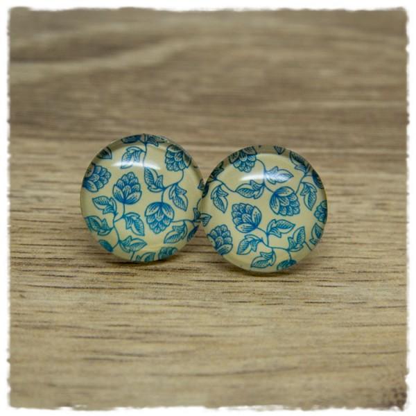 1 Paar Ohrstecker mit blauen Blüten auf beigem Hintergrund