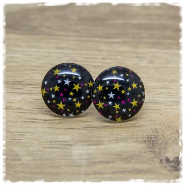 1 Paar Ohrstecker schwarz mit weißen, pinken und goldenen Sternen