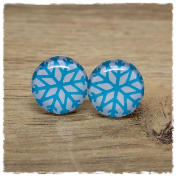 1 Paar Ohrstecker mit blauer Eisblume auf weißem Hintergrund
