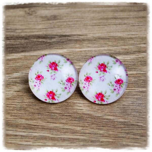 1 Paar Ohrstecker mit roten Blüten auf weißem Hintergrund