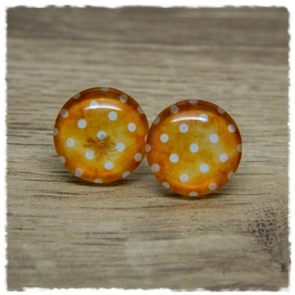 1 Paar Ohrstecker mit weißen Punkten auf gelb-orangem Hintergrund