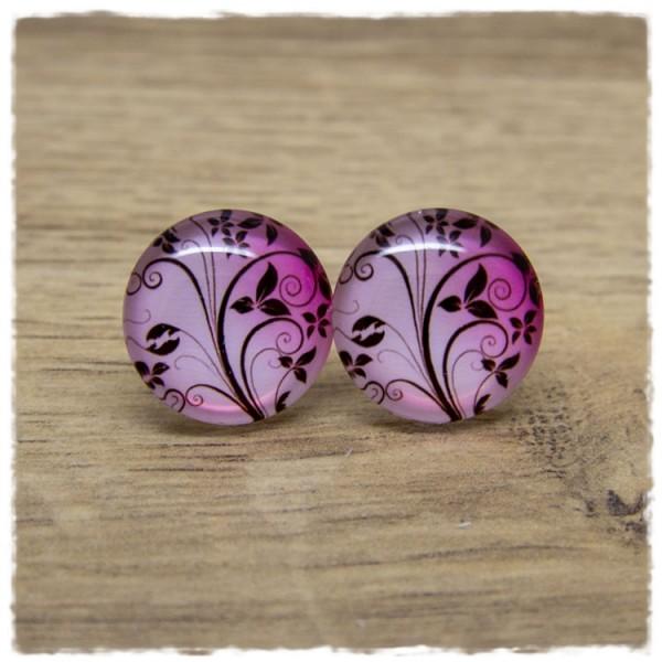 1 Paar Ohrstecker mit floralem Muster auf rosa pinkem Hintergrund