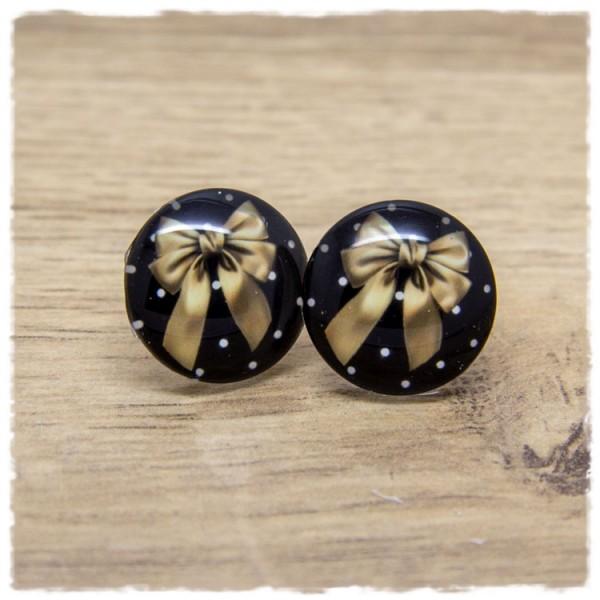 1 Paar Ohrstecker mit goldener Schleife auf schwarz weißem Hintergrund