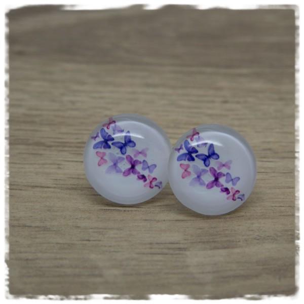 1 Paar Ohrstecker mit lila Schmetterlingen auf weißem Hintergrund