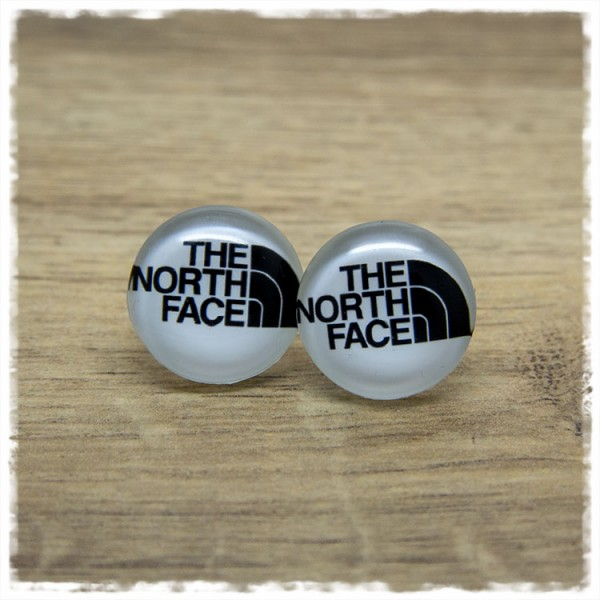 1 Paar Ohrstecker mit THE NORTH FACE