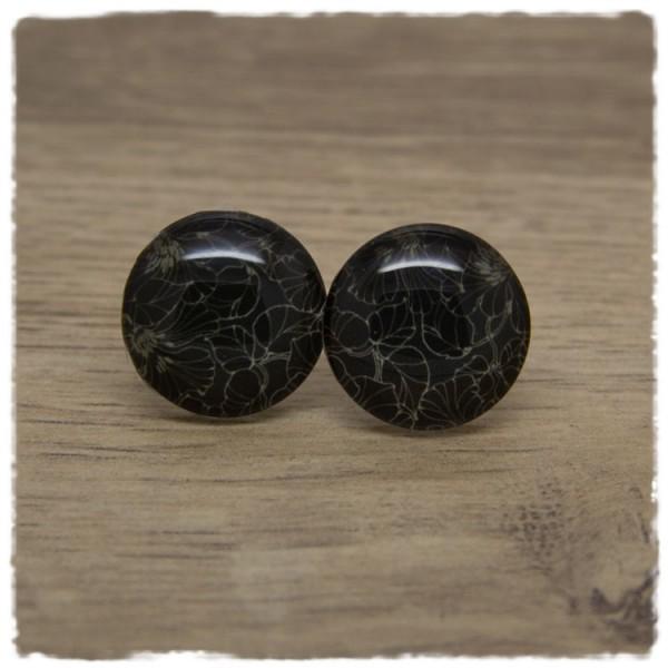 1 Paar Ohrstecker schwarz mit goldenen Blütenumrissen