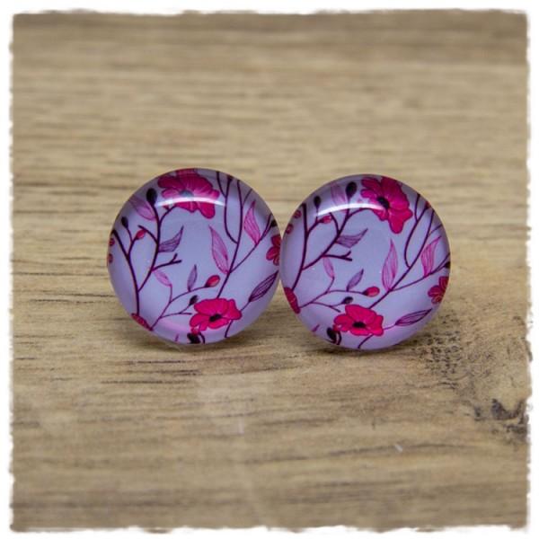 1 Paar Ohrstecker mit pinken Blüten auf grauem Hintergrund