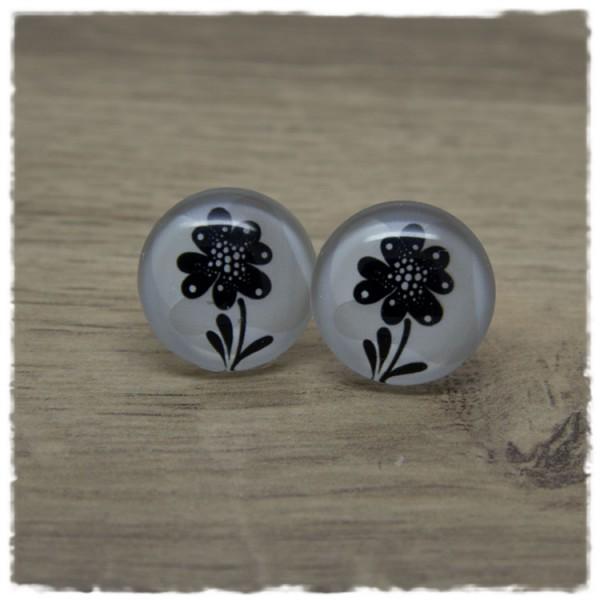 1 Paar Ohrstecker mit schwarzer Blume auf weiß beigem Hintergrund