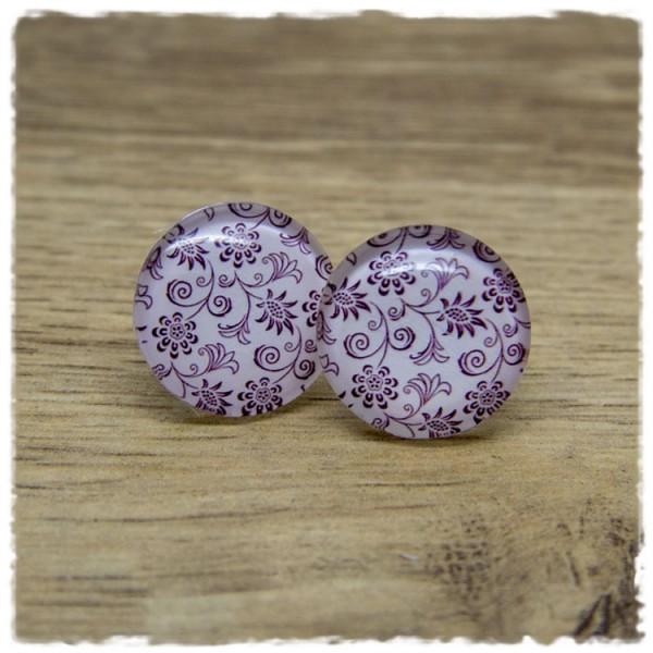 1 Paar Ohrstecker mit floralem Muster auf rosa Hintergrund