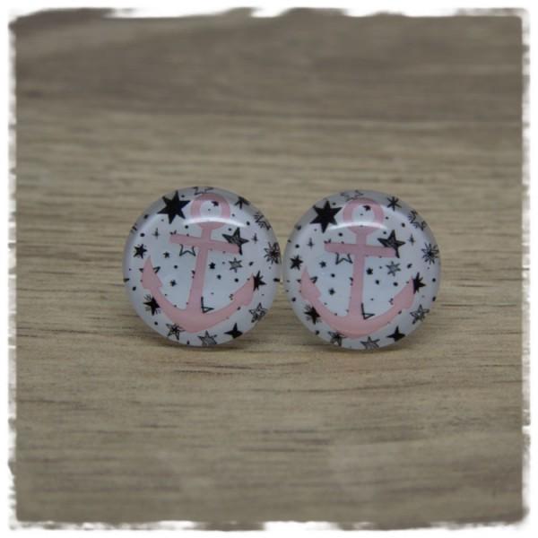 1 Paar Ohrstecker mit rosa Anker auf weißem Hintergrund mit Sternen