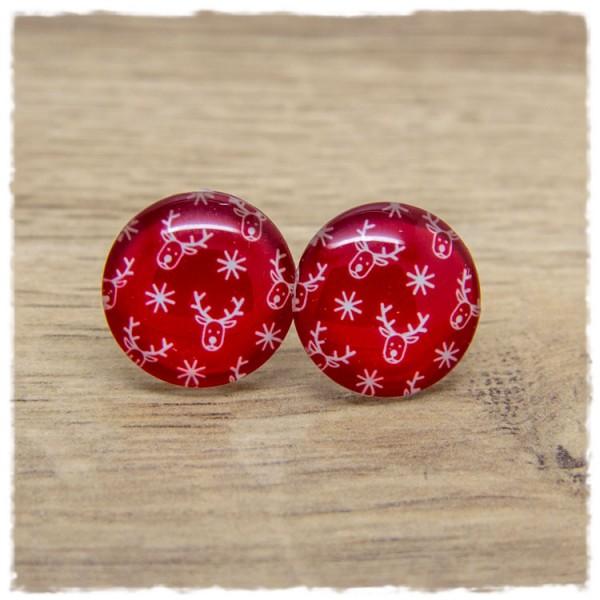 1 Paar Ohrstecker mit Rentieren und Sternen auf rotem Hintergrund