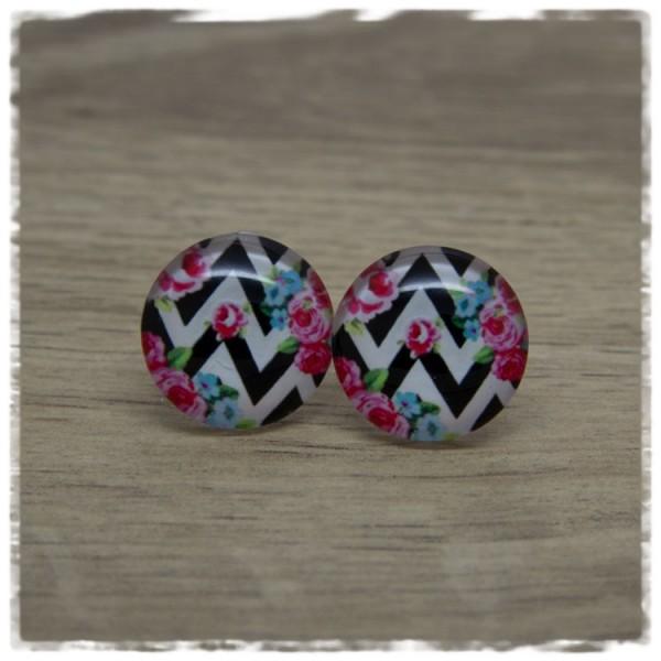 1 Paar Ohrstecker mit pinken Blüten auf schwarz weißen Zacken