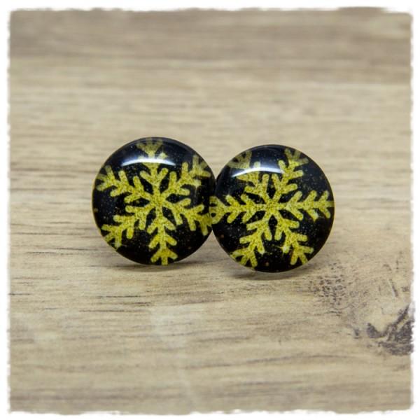 1 Paar Ohrstecker in 20 mm mit goldener Schneeflocke auf schwarzem Hintergrund